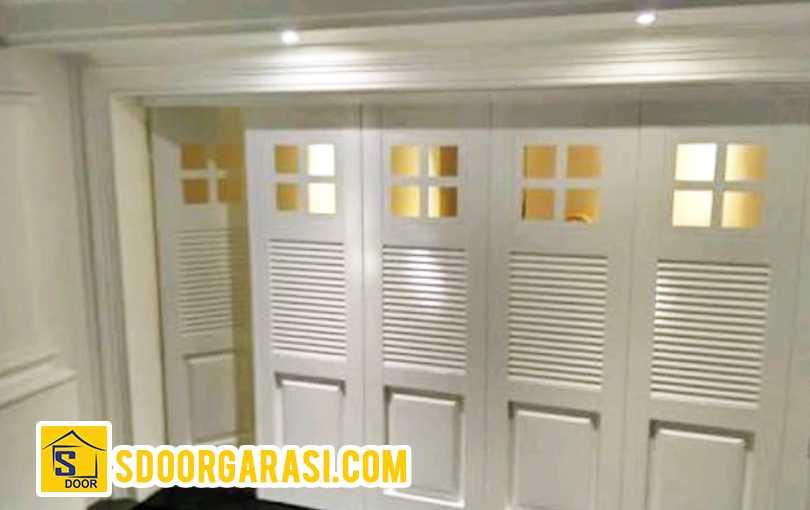 project jasa pemasangan pintu garasi purimas surabaya